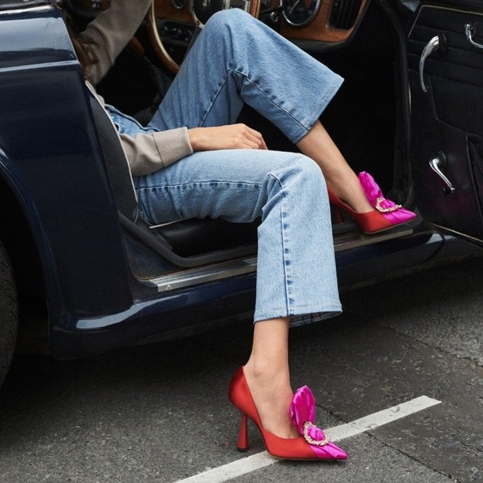The pink and red embellished Lyz pumps worn with jeans