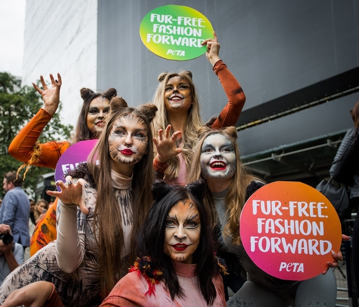 PETA supporters celebrate the news that London Fashion Week will not showcase any animal fur