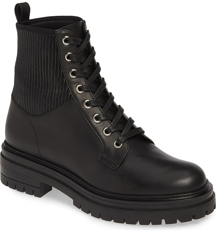 cElevate your street-storming style with this black Italian-made boot of fine leather with a classic lug sole and a ribbed panel wrapping the back