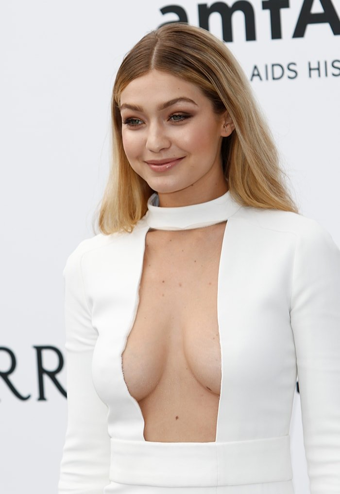 Gigi Hadid goes braless in her white plunging gown at the 68th Cannes Film Festival on May 21, 2015
