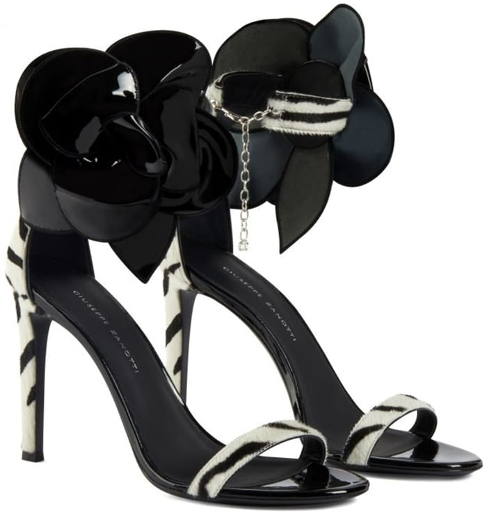 These high-heel, black and white, zebra print pony sandals feature a single front strap, and are characterized by the black patent 'Rose' accessory on the side