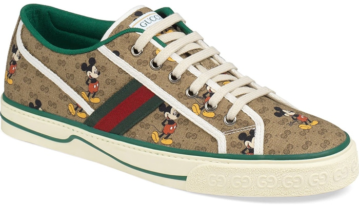Gucci celebrates Mickey Mouse with a canvas sneaker that combines the cartoon's nostalgic charm with the fashion house's own heritage