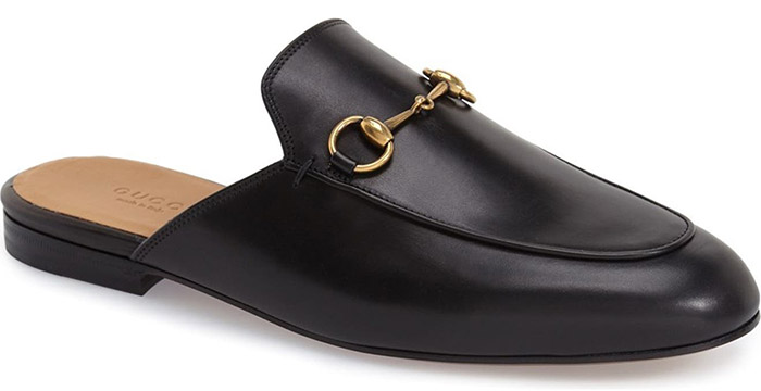Signature goldtone horsebit hardware hearkens back to Gucci's equestrian roots on a classic loafer updated in a sleek, slip-on mule silhouette
