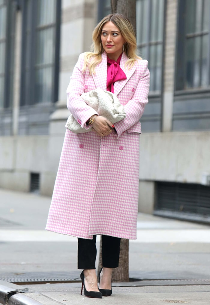 Hilary Duff wearing a pink houndstooth Balenciaga coat with a Chloe pussy-blouse