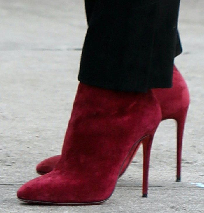 Hilary Duff adds a pop of red to her look with Christian Louboutin Eloise booties