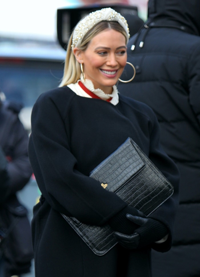 Hilary Duff styles her straightened blonde hair with Lele Sadoughi crystal-embellished headband