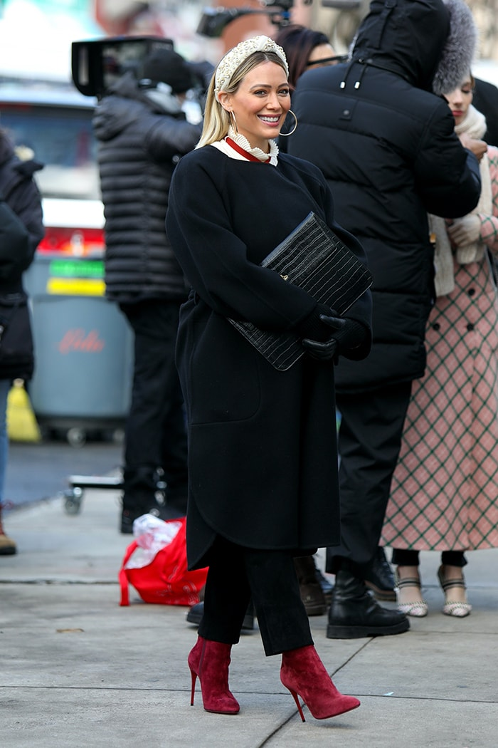 Hilary Duff looks winter chic in a Chloe belted robe coat and a red necktie blouse