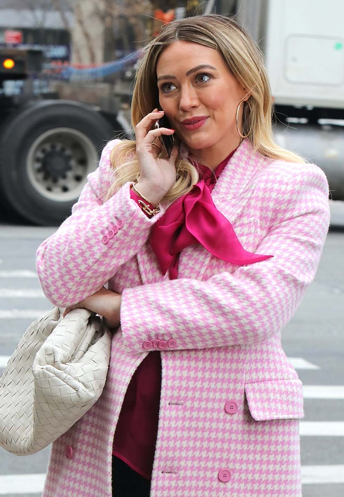 Hilary Duff complements her feminine pink outfit with pink blush and lipstick