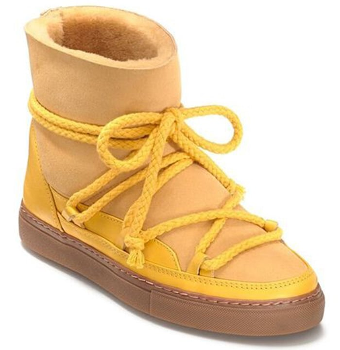 This yellow winter sneaker features shearling that will keep you warm and comfortable
