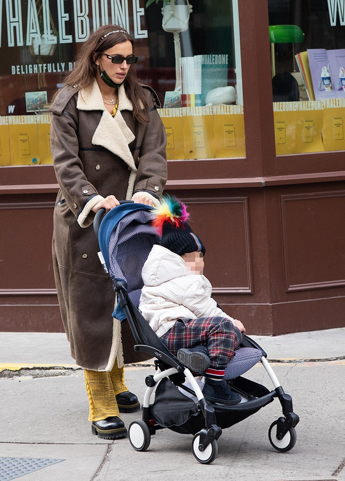 Irina Shayk bundles up in a chic The Mannei Jordan brown leather overcoat