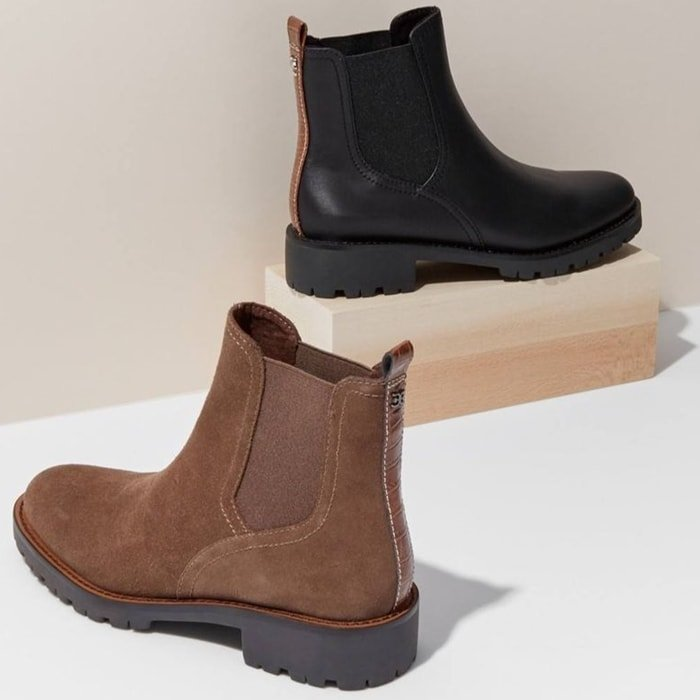 A lugged sole combined with contrast panel at the counter update a take-charge boot in a classic Chelsea silhouette from Sam Edelman