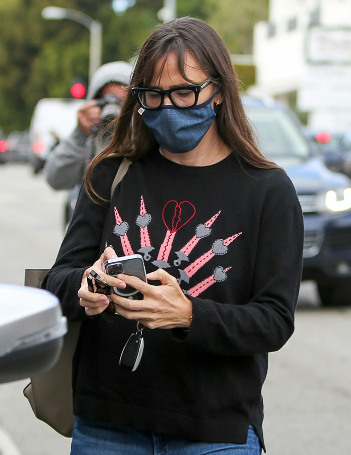 Jennifer Garner stays safe from COVID19 with a blue denim face mask