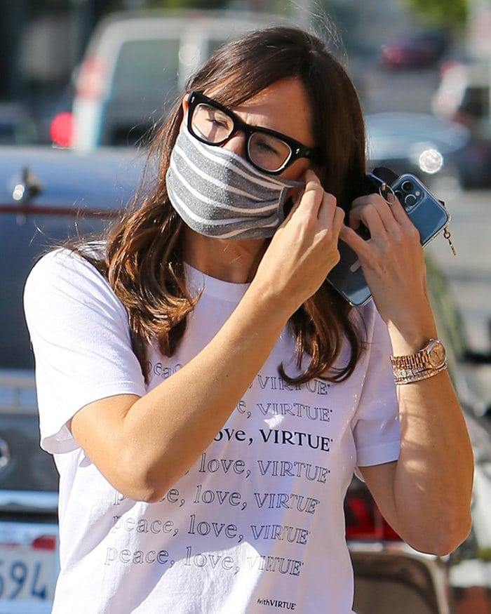 Jennifer Garner amps up her casual outfit with diamond bracelets and a gold Rolex watch