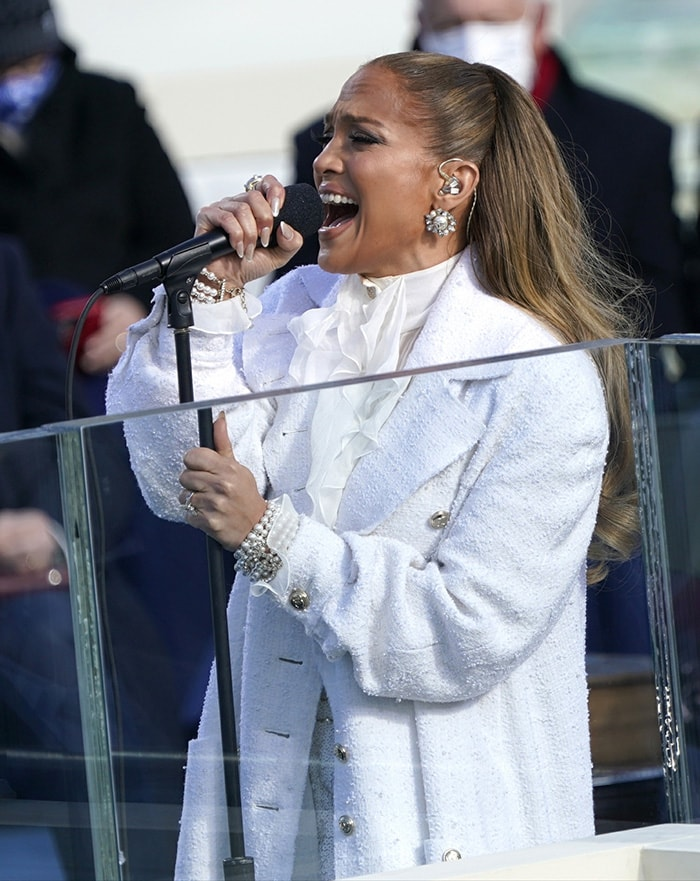 Jennifer Lopez performs This Land Is Your Land and America the Beautiful at the 2021 Presidential Inauguration on January 20, 2021