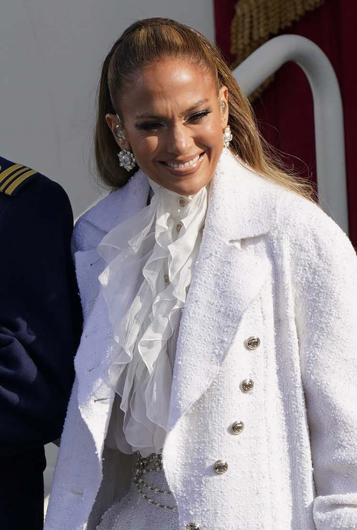 Jennifer Lopez pulls her hair back into a ponytail and styles her look with oversized Chanel earrings