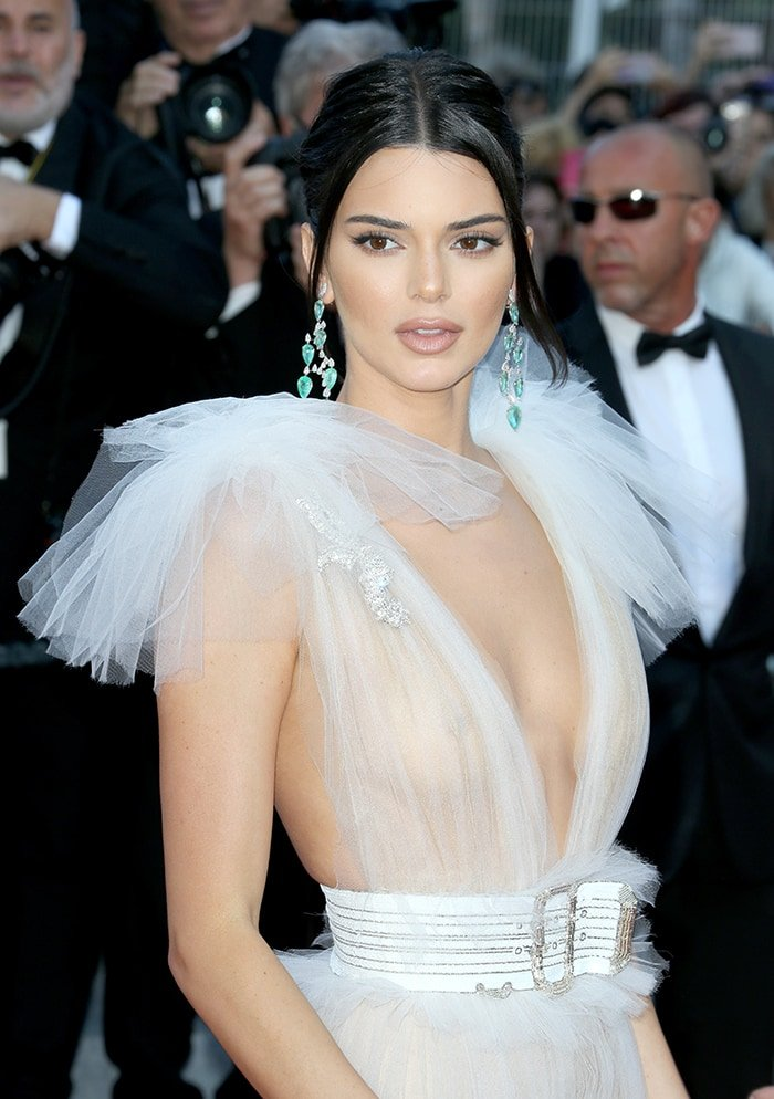 Kendall Jenner gives a glimpse of her boobs in a sheer Schiaparelli Haute Couture gown at the 71st Annual Cannes Film Festival on May 12, 2018