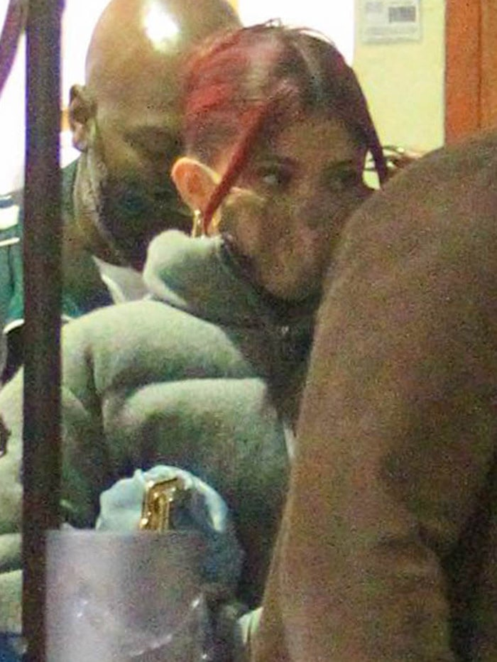 Kylie Jenner wears her red hair up and stays protected with a Skims face mask