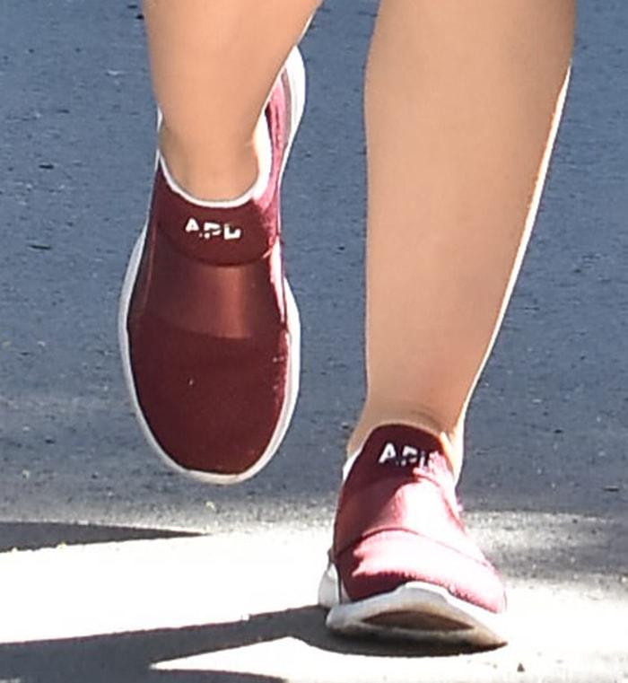 Lucy Hale slips into a pair of APL TechLoom Bliss shoes