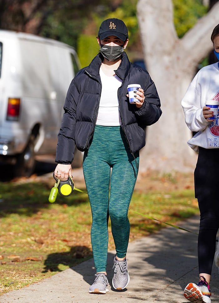 Lucy Hale highlights her toned legs in Outdoor Voices green leggings