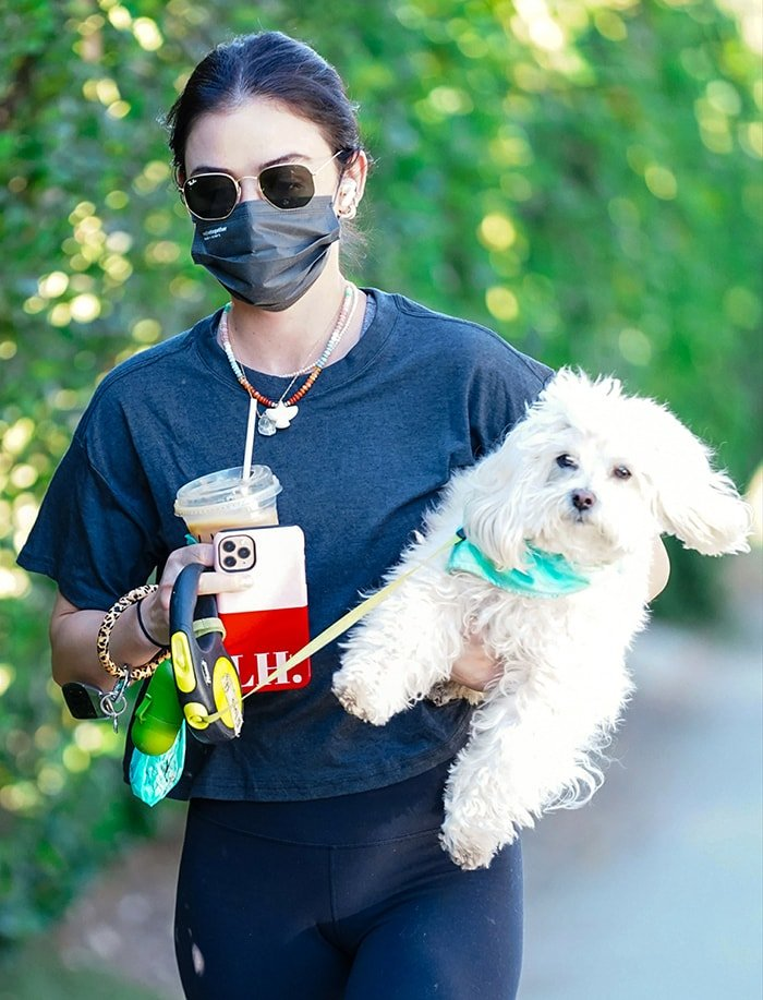 Lucy Hale keeps a low profile with Ray-Ban sunnies and stays safe with a black face mask