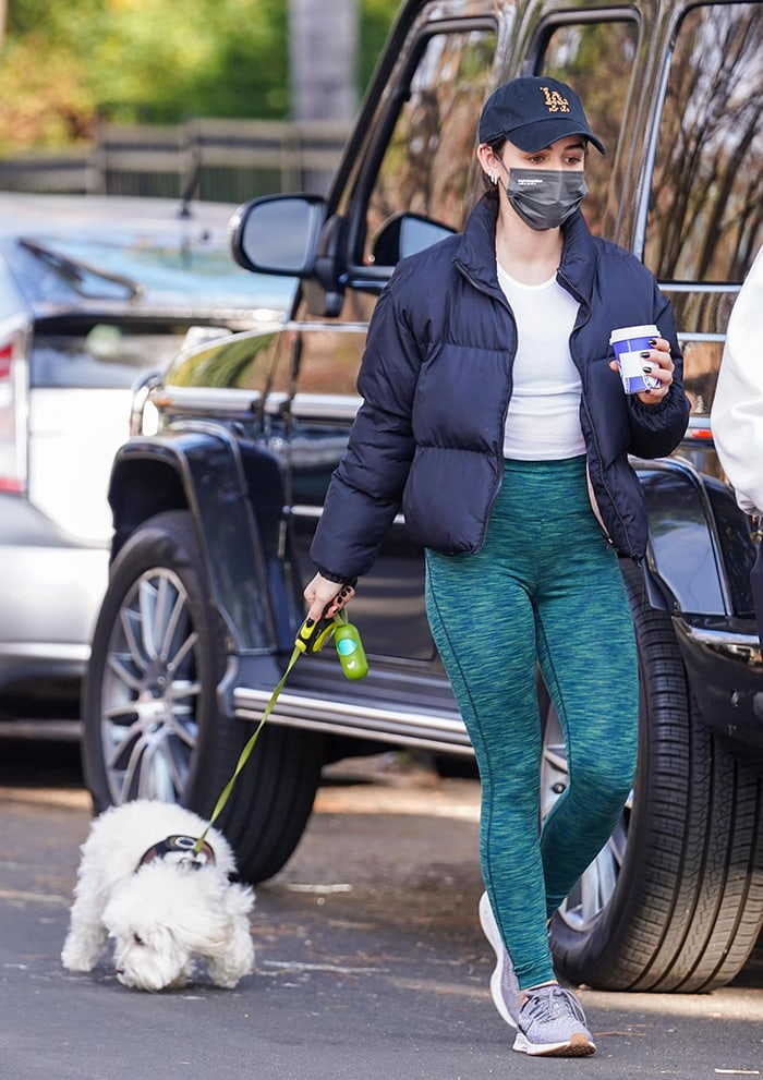 Lucy Hale walks her dog Elvis in Los Angeles on January 5, 2020 after co-hosting Dick Clark's Rockin' New Year's Eve