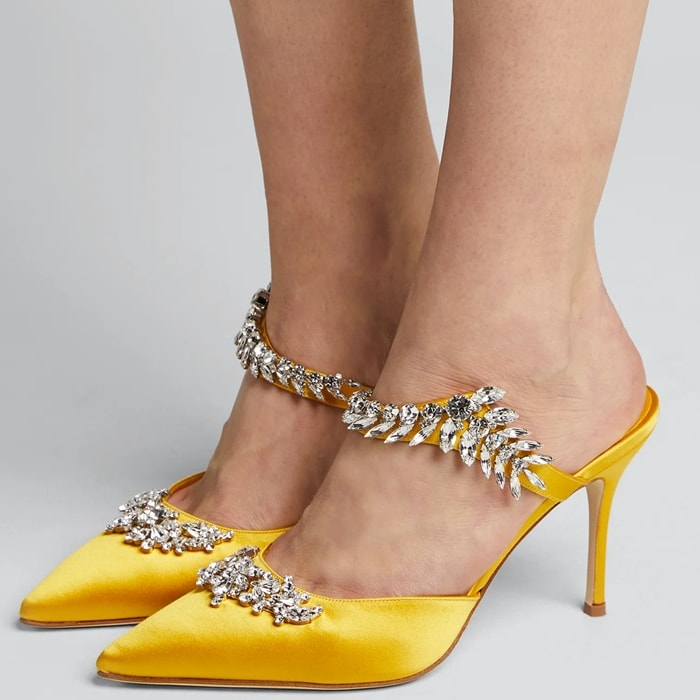 Decadent crystal leaves vine across this pointy-toe satin pump, showcasing Manolo Blahnik's flair for dramatic embellishment
