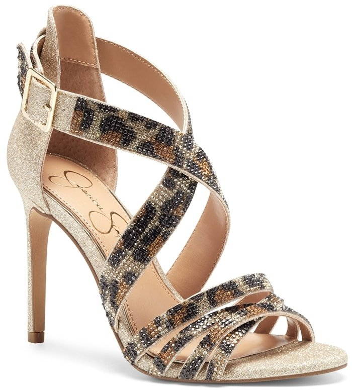 Allover crystals add an eye-catching gleam to the wide, crisscrossing straps of this standout stiletto sandal