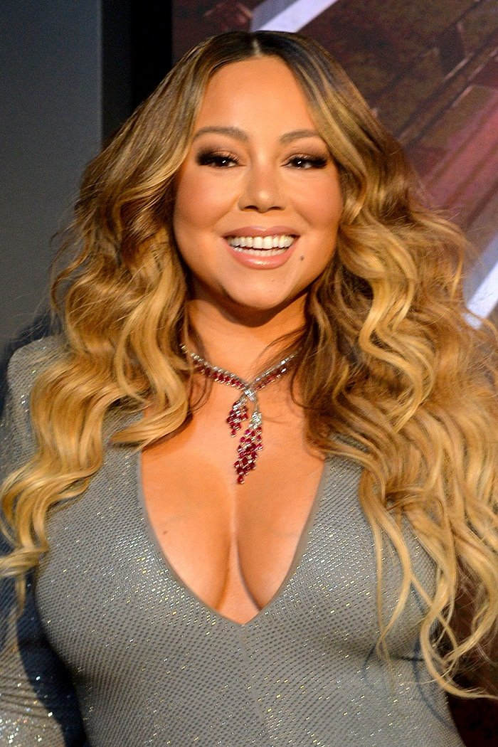 Mariah Carey shows off her big boobs as she lights up the Empire State Building in Alexandre Vauthier gown on December 17, 2019