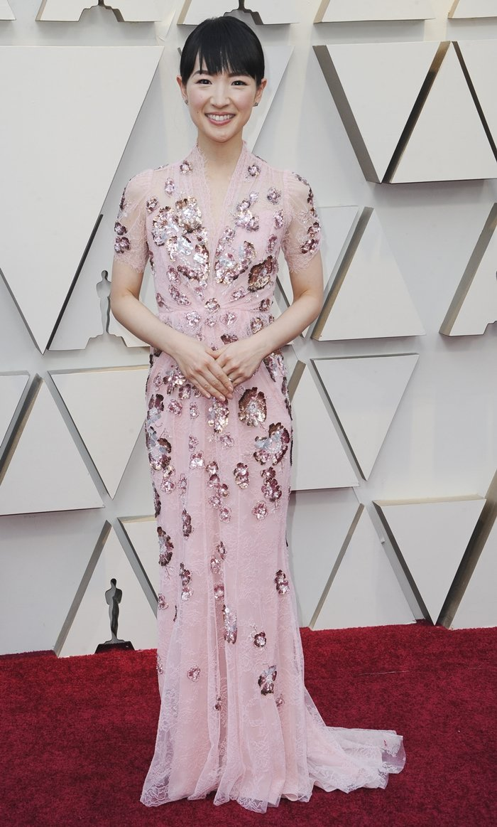 Marie Kondo, whose net worth is estimated to be around $8 million, wore a floor-sweeping Jenny Packham dress at the 91st Annual Academy Awards