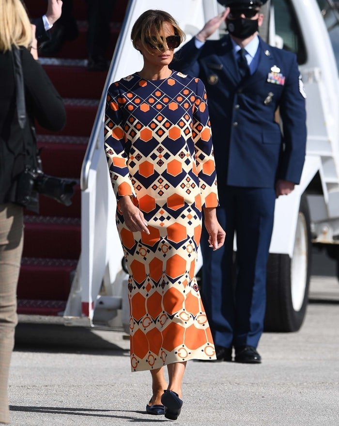 Melania Trump's silk and wool cady maxi dress from Gucci is inspired by the psychedelic prints and distorted imagery of the 1970s