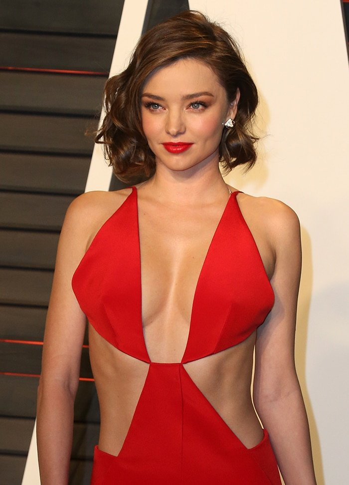 Miranda Kerr shows off her cleavage and slim figure at the 2016 Vanity Fair Oscar Party on February 28, 2016