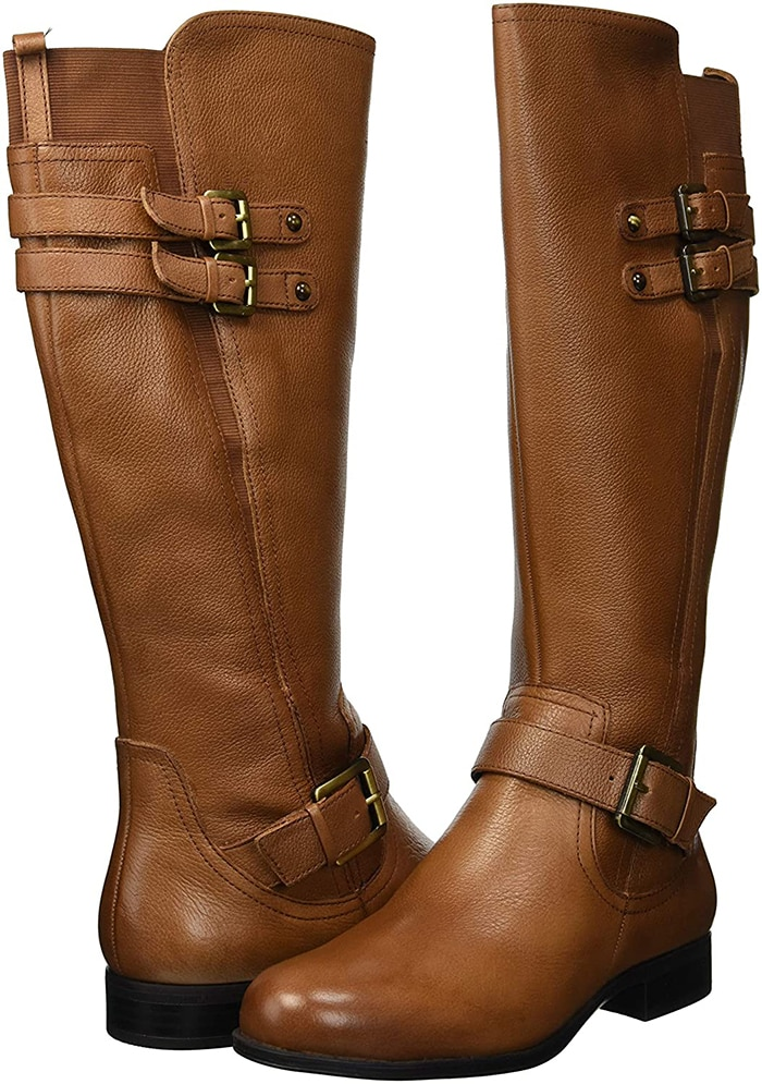 Beautifully polished with pebbled leather, wraparound straps, gold-toned buckles, and a defined silhouette, this boot is always along for the ride