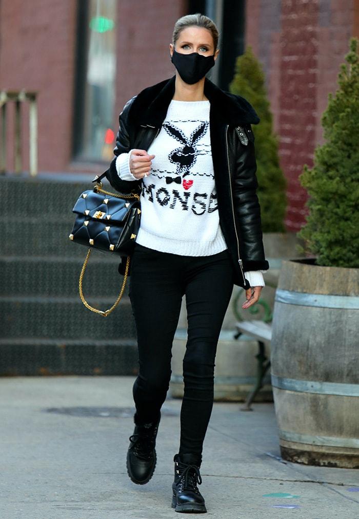 Hilary Duff teams a Muubaa biker jacket with a Monse x Playboy sweater