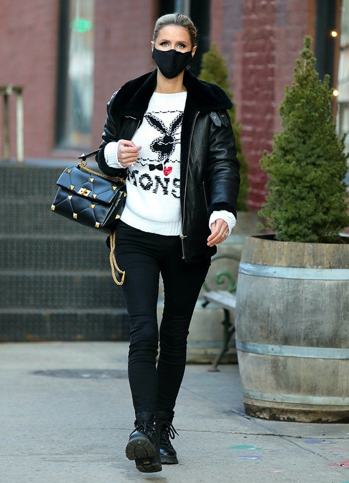 Nicky Hilton totes a black Valentino Garavani Roman Stud shoulder bag in Manhattan