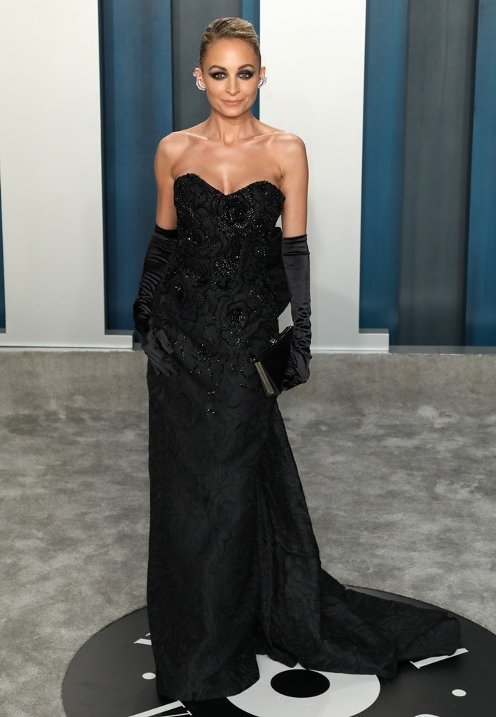 Nicole Richie wears a black strapless Etro Couture dress and Ana Khouri jewelry at the 2020 Vanity Fair Oscar Party