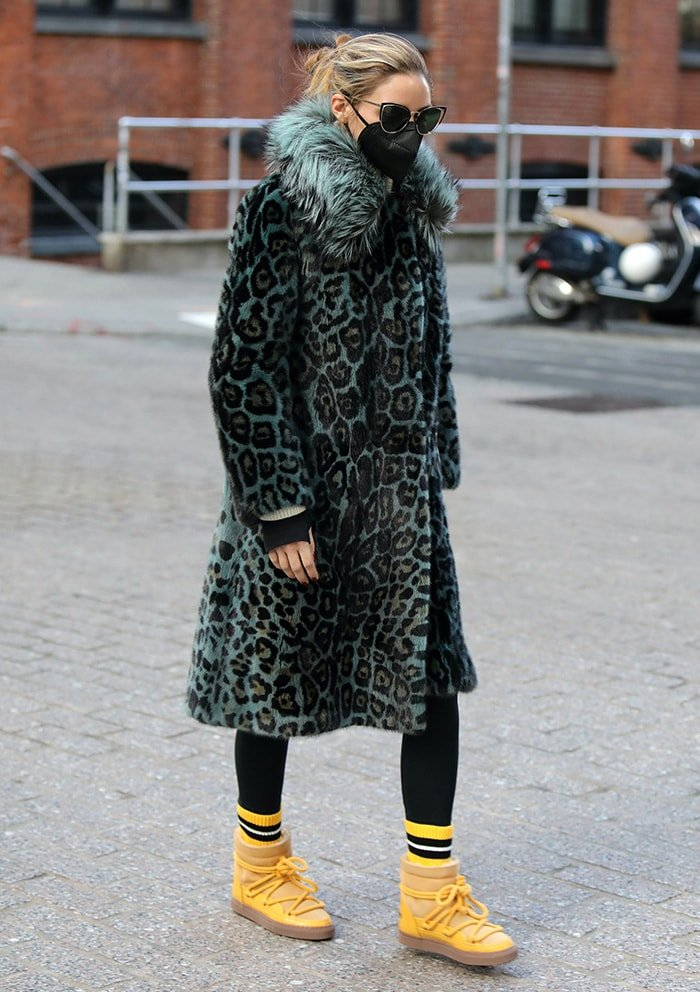 Olivia Palermo turns heads in a teal Cara Mila leopard mink fur coat and yellow boots
