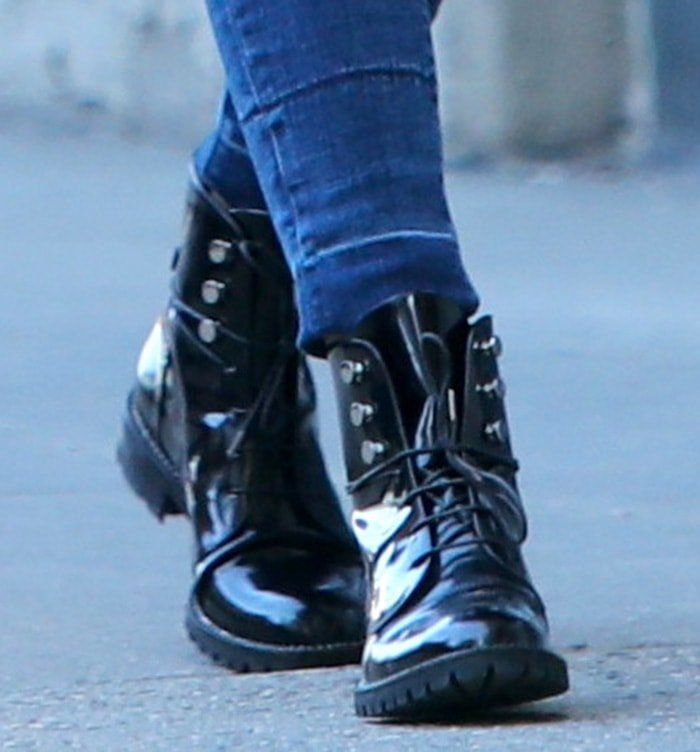 Olivia Palermo adds a hint of tough-chic vibe to her look with Dior Rebelle Army boots