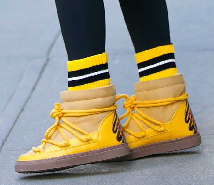 Olivia Palermo adds color to her look with Inuikii yellow sneaker boots
