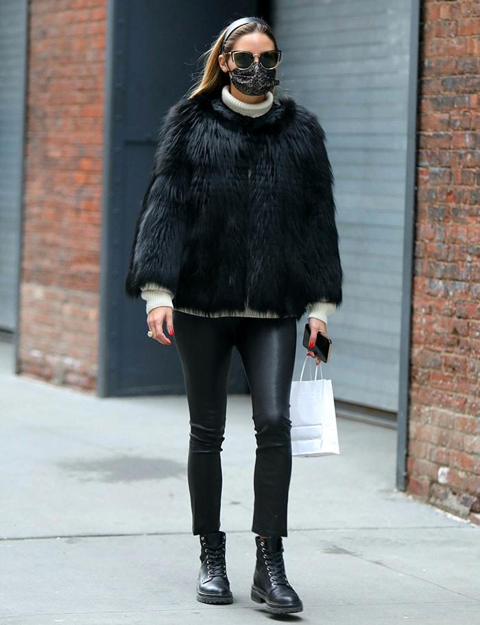 Olivia Palermo teams a black Pologeorgis shaggy jacket with black pleather pants