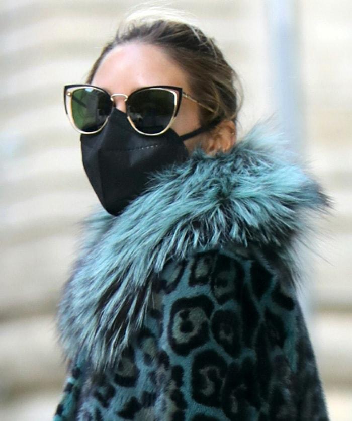Olivia Palermo styles her look with Salvatore Ferragamo cat-eye sunglasses