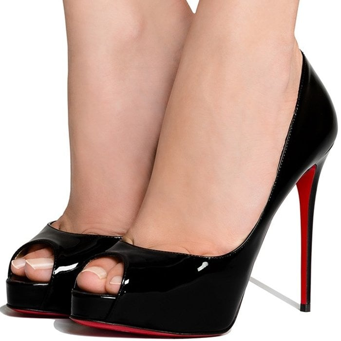 Lustrous patent leather defines this peep-toe design, subtly lifted by a hidden platform and stiletto heel