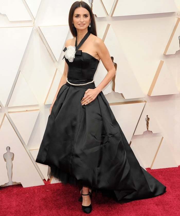 Penelope Cruz wears a Chanel Haute Couture bustier black silk dress with Atelier Swarovski jewelry at the 92nd Annual Academy Awards