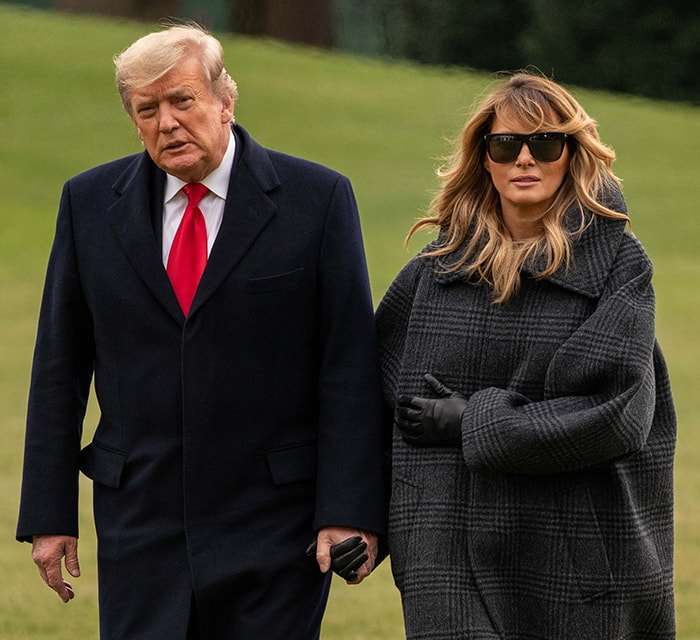 Melania Trump bundles up in an oversized Balenciaga check-print coat