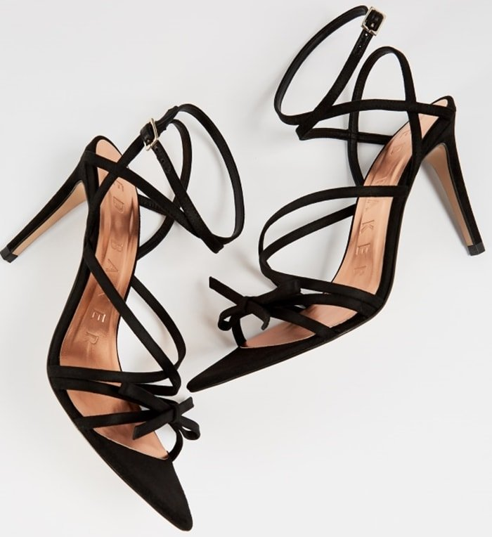 This strappy special occasion sandal is crafted with a leather upper and features crisscrossing straps for an elevated look