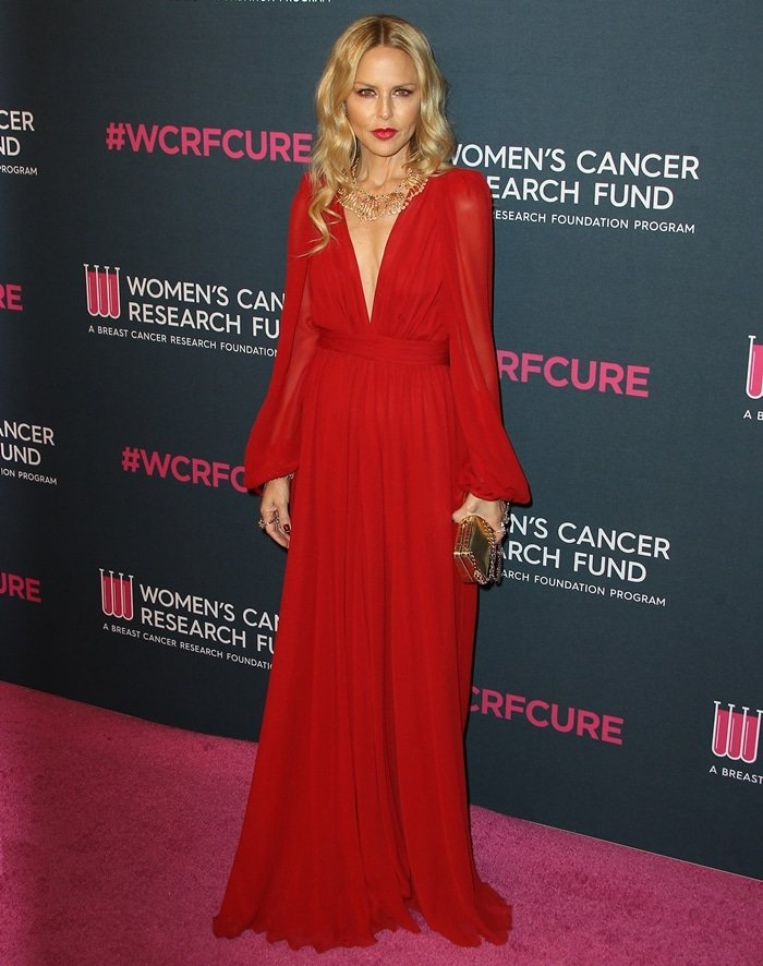 Rachel Zoe wears a red V-neck dress with long sleeves at the Women's Cancer Research Fund's 'An Unforgettable Evening'