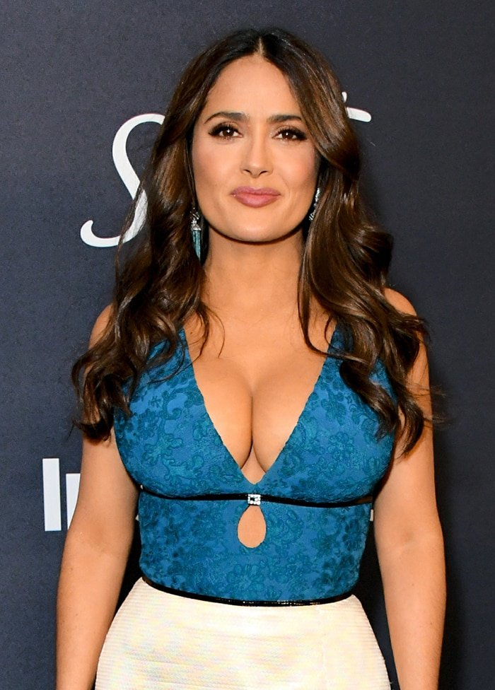 Salma Hayek's full round bosom in Gucci dress at the InStyle and Warner Bros Golden Globes After Party on January 5, 2020