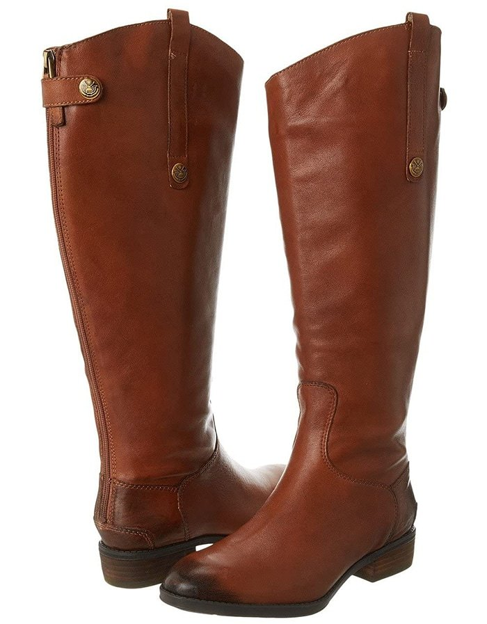 A rich, burnished finish enhances a knee-high leather boot with a svelte slanted shaft