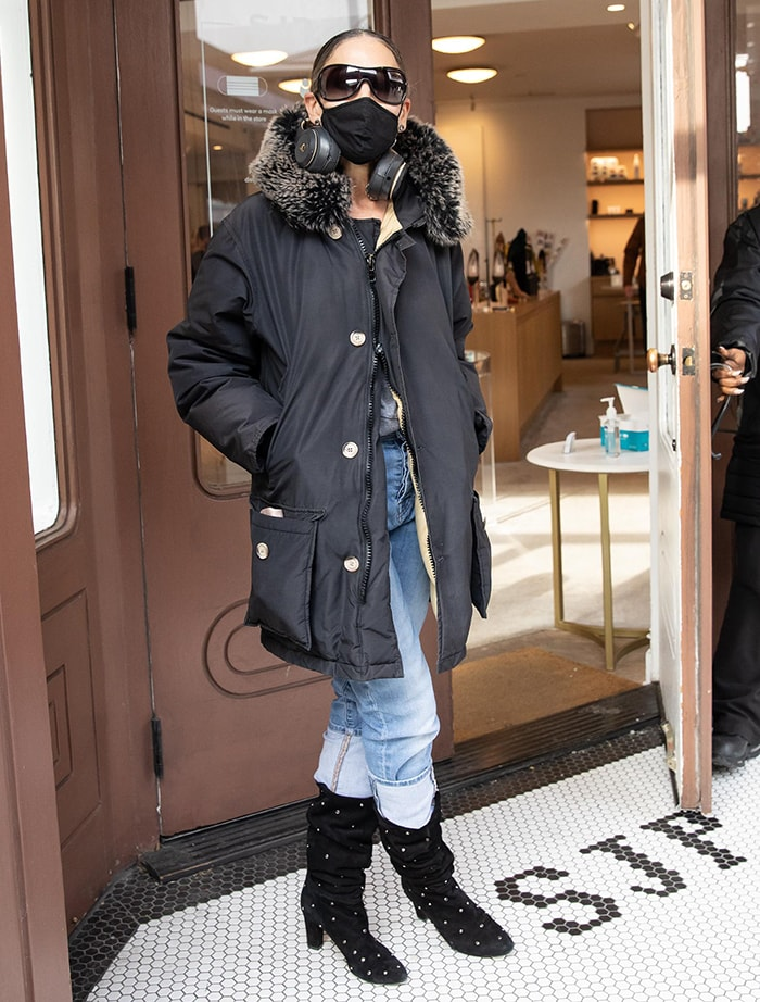 Sarah Jessica Parker looks chic in a faux-fur-trimmed jacket and studded boots at her South Street Seaport boutique on January 13, 2021