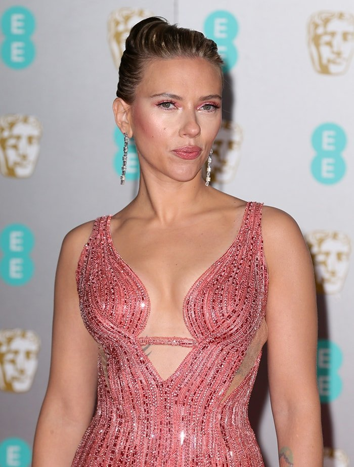 Scarlett Johansson proudly shows off her cleavage and famous curves in Versace gown at The EE BAFTA 2020 on February 2, 2020
