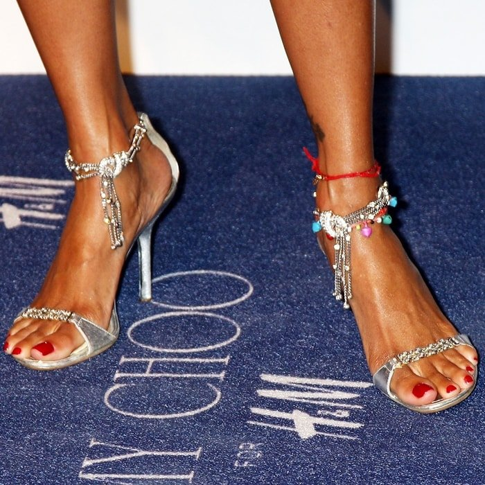 Stacey Dash shows off her size 8 (US) feet at the Jimmy Choo for H&M Collection private event